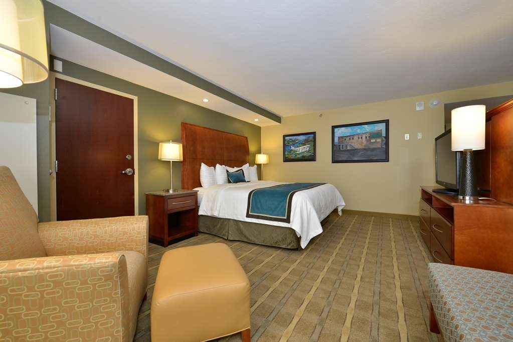 Best Western Premier Waterfront Hotel & Convention Center - The large one room Executive Suites feature a functional half wall, a king bed with a pillow top mattress, and two overstuffed chairs.