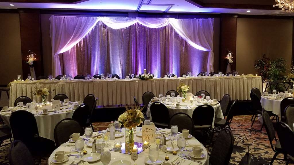 Best Western Premier Waterfront Hotel & Convention Center - Wedding reception with close-up of table setting, held in the Athearn Ballroom of the hotel.