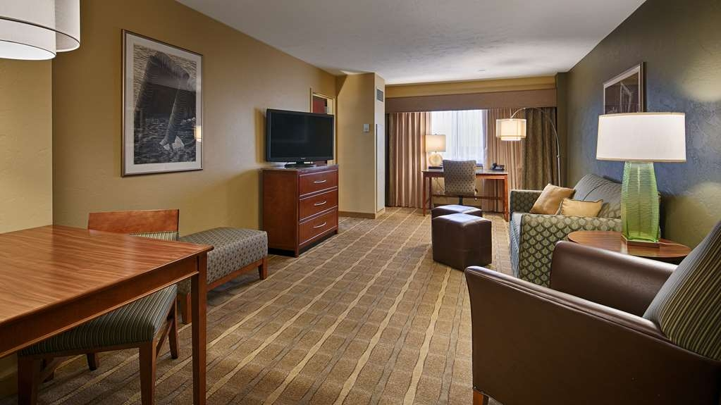 "Best Western Premier Waterfront Hotel & Convention Center - The sitting room of this two room whirlpool/fireplace suite features a 42"" high definition flat screen television and large granite top work desk."