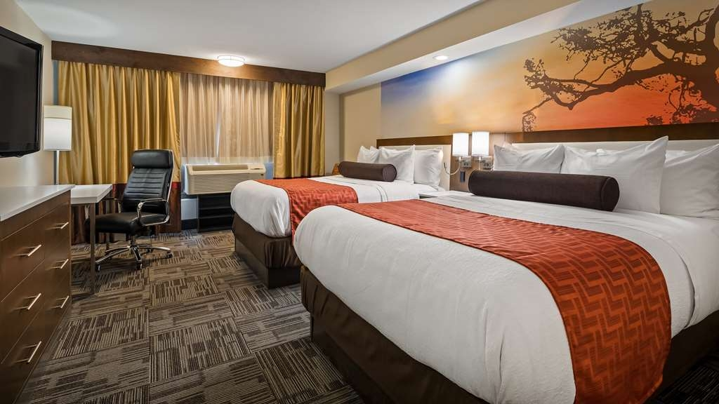 Best Western Premier Milwaukee-Brookfield Hotel & Suites - Stretch out and relax in our guest rooms.
