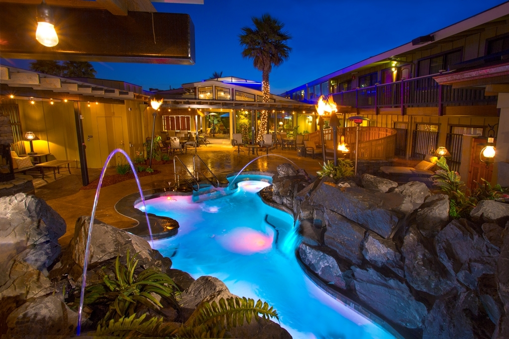 "Best Western Plus Humboldt Bay Inn - New ""Oasis"" Spa Area featuring waterfalls, fireplace, firepit, tiki tourches, plush seating and more."