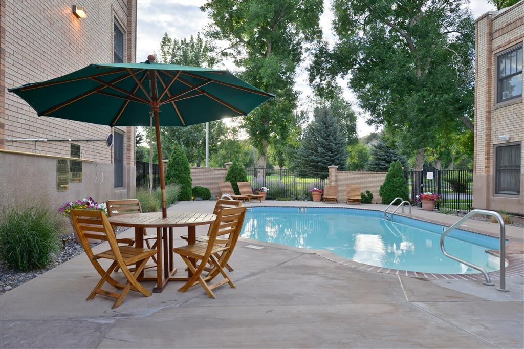 Best Western Plus Plaza Hotel - Enjoy the rising sun with your morning coffee in our pool area.