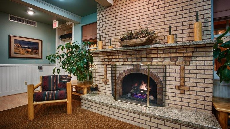 Best Western Plus Plaza Hotel - Our fireplace in the lobby is almost 100 years old!