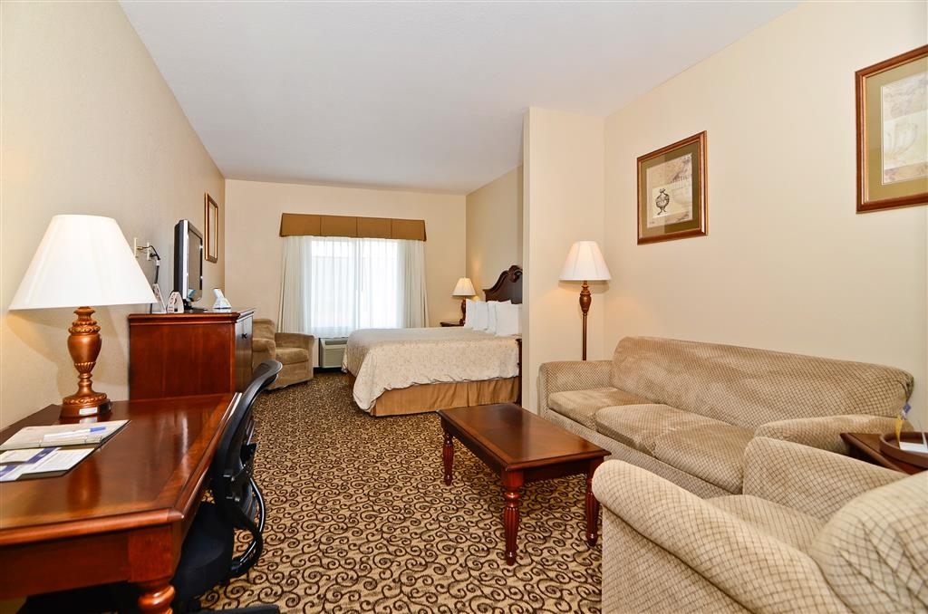 Best Western Plus Fossil Country Inn & Suites - Our king suite includes free wireless Internet, work desk, sitting area, flat screen TV, comfortable bed and a good night's rest.