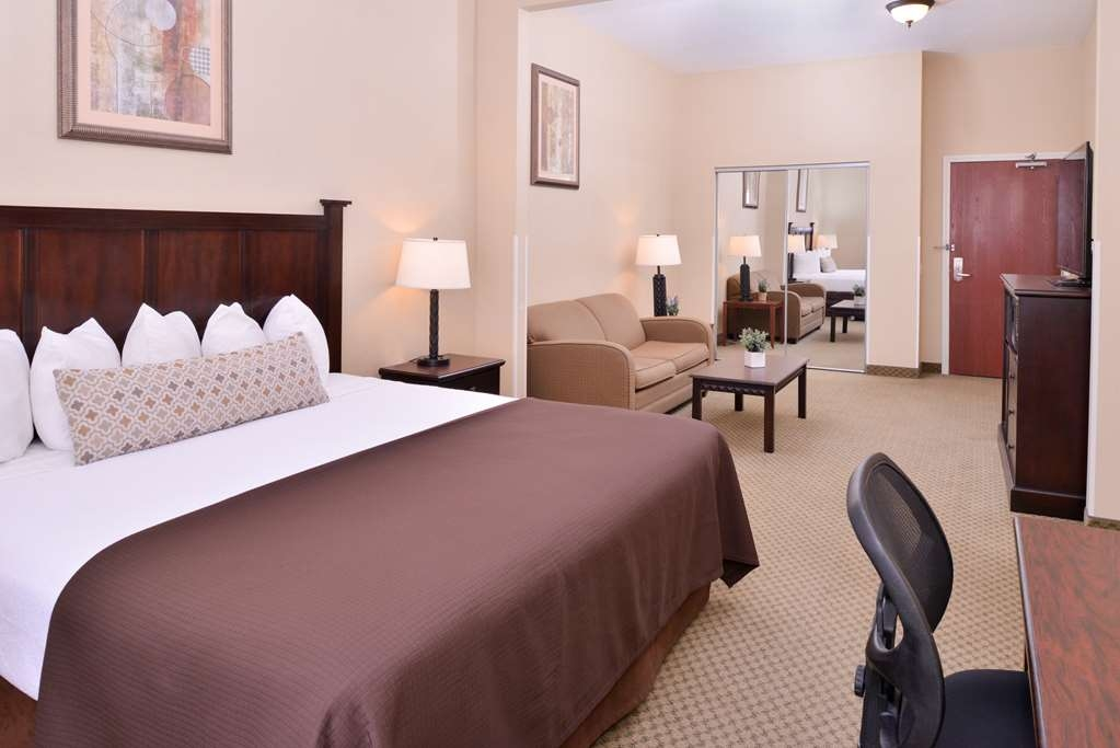 Best Western Plus Frontier Inn - Our king extended room is great for families or business travelers! The couch pulls out into a sofa bed for more room.