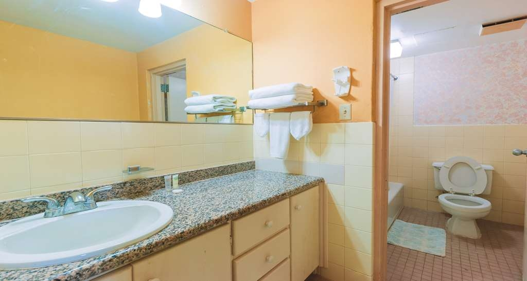 SureStay Hotel by Best Western Guam Airport South - Our guest bathrooms have a large vanity with plenty of room to unpack the necessities.
