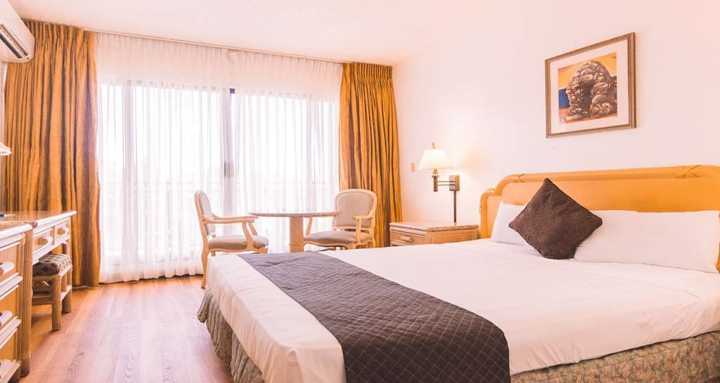 SureStay Hotel by Best Western Guam Airport South - Sink into our comfortable beds each night and wake up feeling completely refreshed in our king deluxe bedrooms.