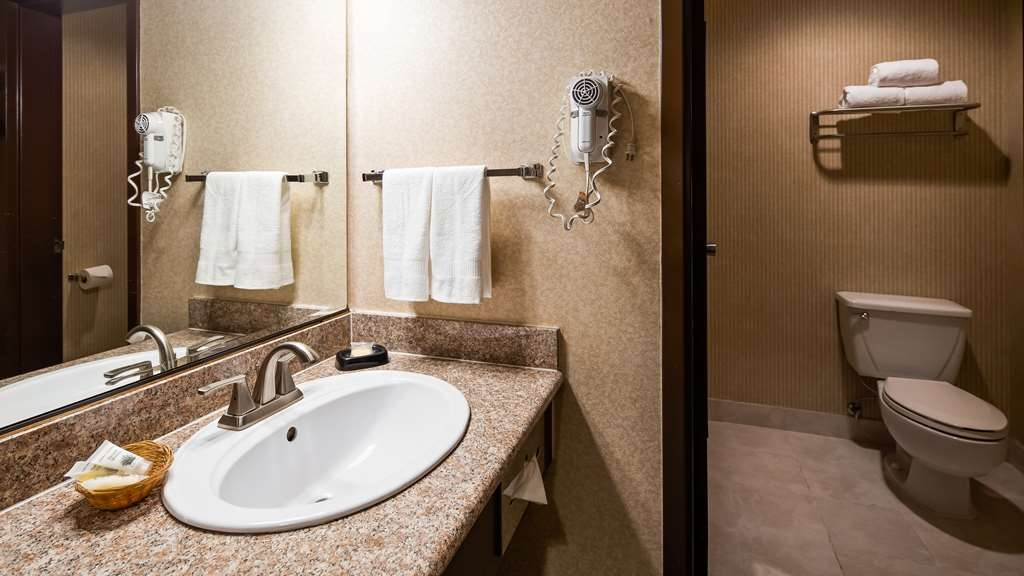 SureStay Plus Hotel by Best Western Reno Airport - All guest bathrooms have a large vanity with plenty of room to unpack the necessities.