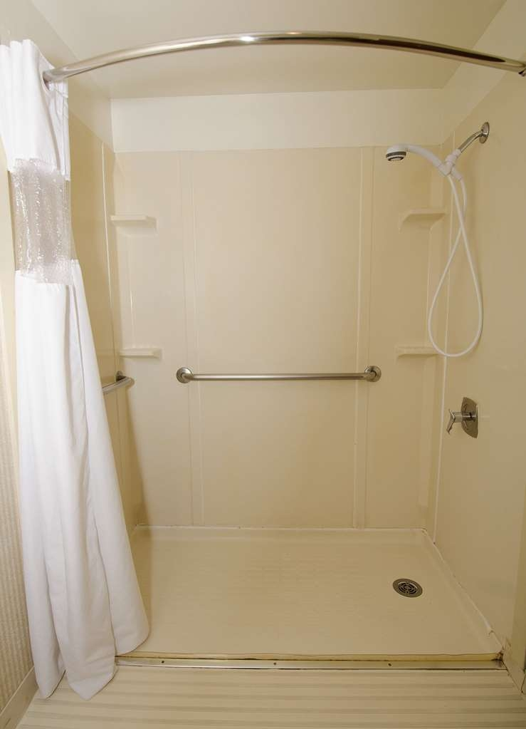 SureStay Plus Hotel by Best Western Reno Airport - We designed our mobility accessible bathroom with a roll-in-shower to meet your needs.