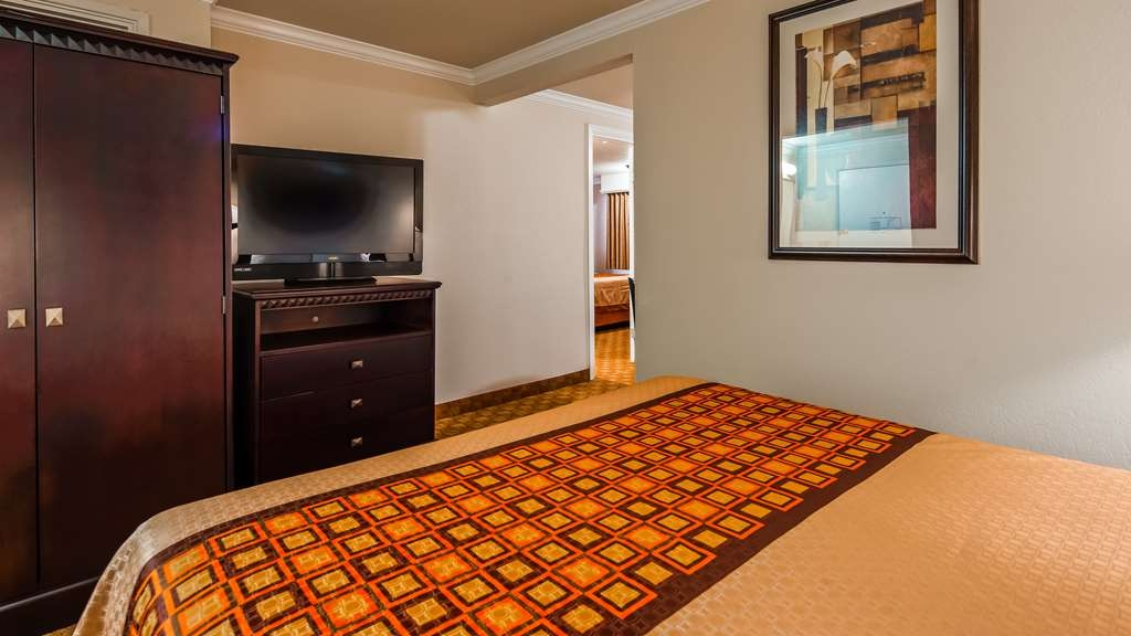 SureStay Plus Hotel by Best Western Lompoc - This queen suite room is equipped with a kitchenette, separate seating area, sofa-bed and 2 flat screen TV's.