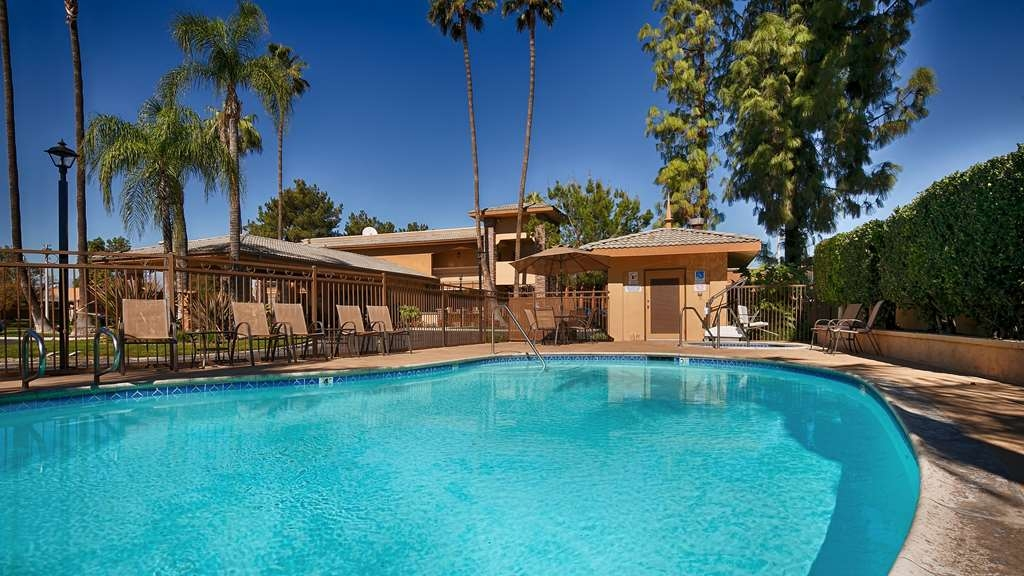 SureStay Plus Hotel by Best Western San Bernardino South - The outdoor pool is perfect for swimming laps or taking a quick dip.