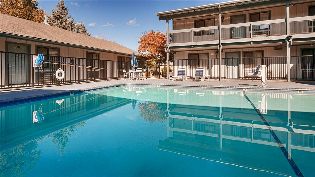 Best Western Miner's Inn - Take a refreshing dip in our sparkling pool, featuring lounge chairs and patio furniture.