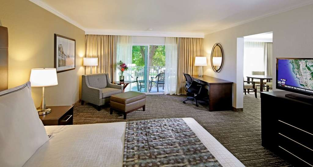 Best Western Plus Garden Court Inn - Enjoy the extra space in our King Suite with Sofa Bed in next room.