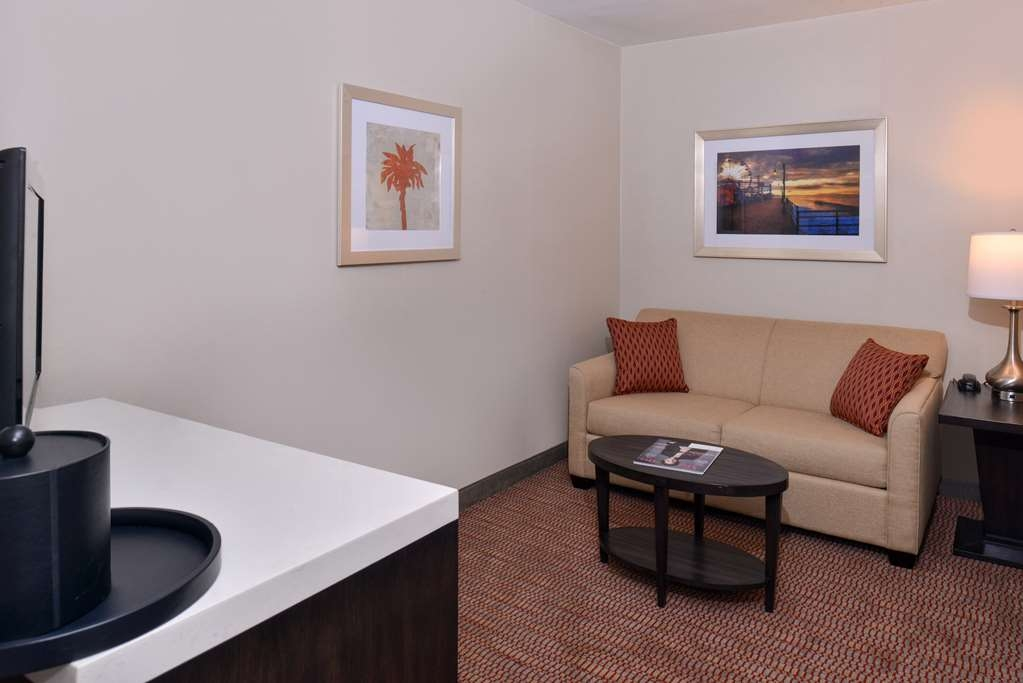 Best Western Royal Palace Inn & Suites - Settle in for the evening and relax in our suite living area.