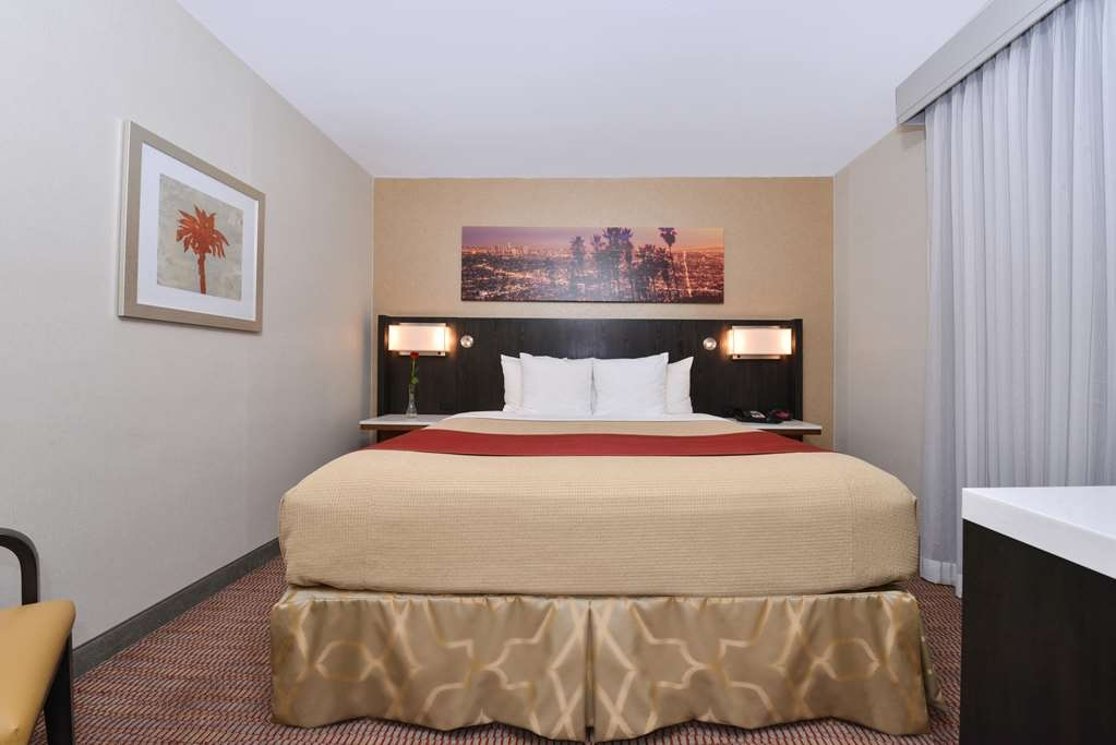 Best Western Royal Palace Inn & Suites - Sink into our comfortable beds each night and wake up feeling completely refreshed.