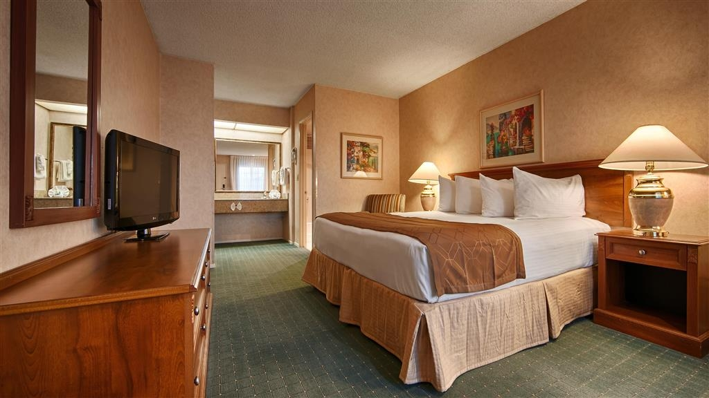 Best Western Corona - King bed guest room includes free high-speed wireless Internet, refrigerator and microwave.
