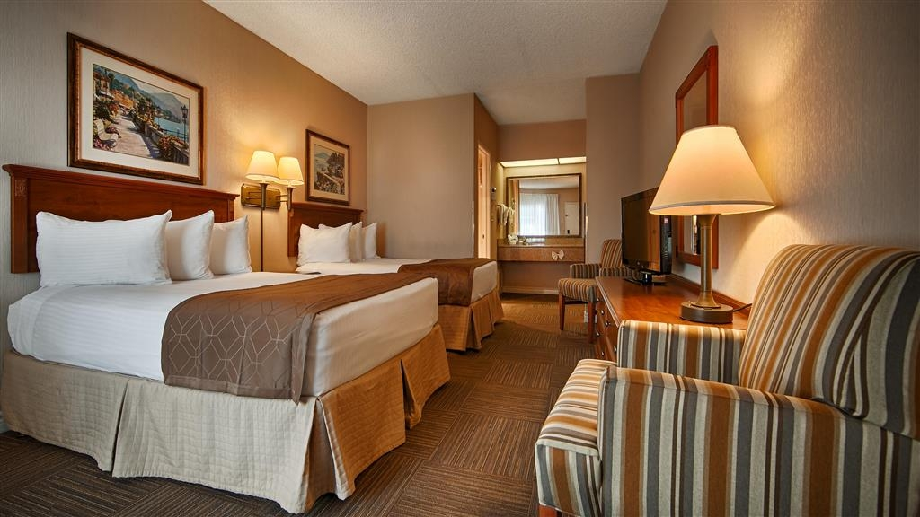 Best Western Corona - Guest room with two double beds includes free high-speed wireless Internet and refrigerator.