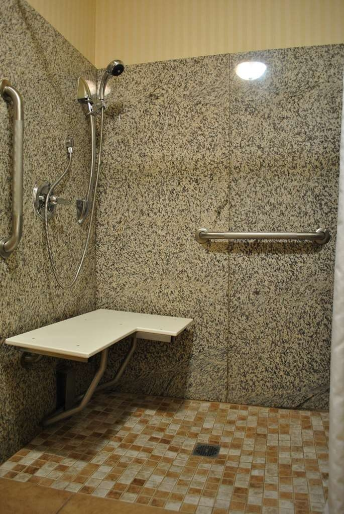 SureStay Plus Hotel by Best Western Buffalo - If you need a little bit of extra space our mobility accessible roll-in shower is equipped to meet your needs.