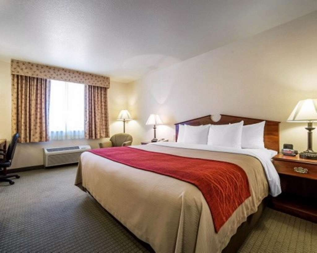 SureStay Plus Hotel by Best Western Buffalo - At the end of a long day, relax in our clean, fresh king bed guest room.