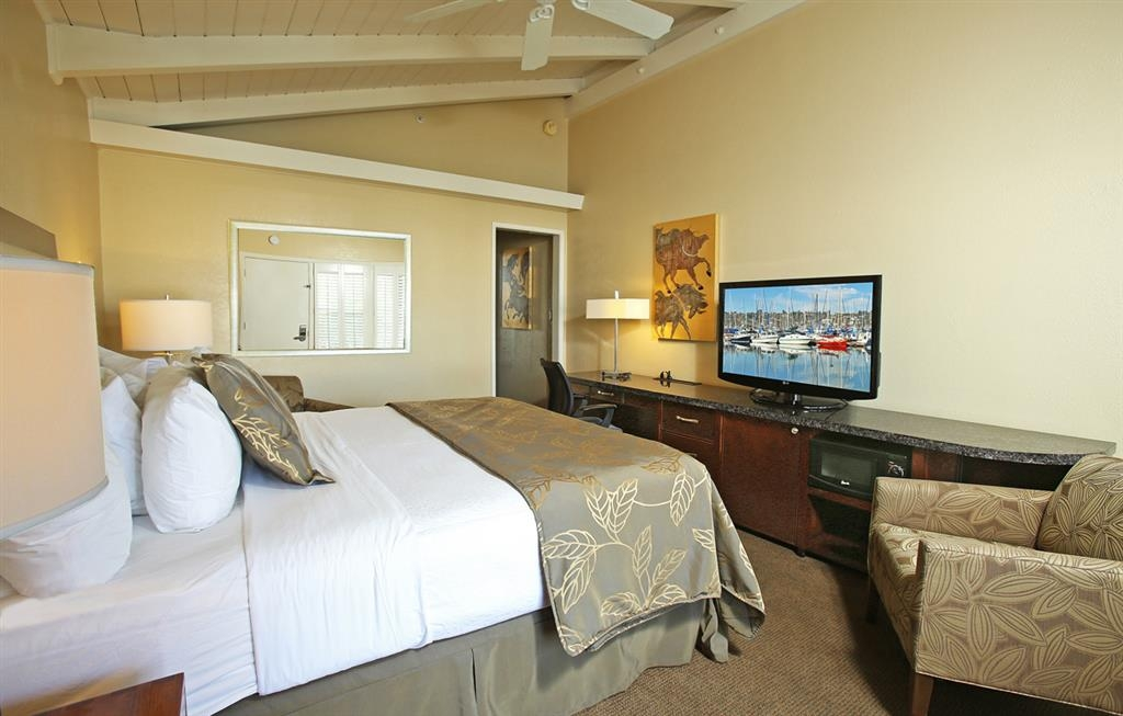 Best Western Plus Island Palms Hotel & Marina - Our traditional, 300 square foot guest rooms come equipped with one king bed and a slab granite vanity and granite and glass-enclosed shower.