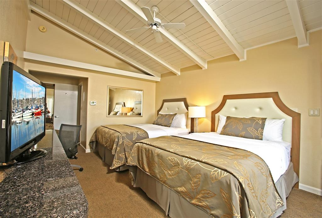 Best Western Plus Island Palms Hotel & Marina - This traditional, 300 square foot guest room has two queen beds and the bathroom features a granite vanity and granite glass-enclosed shower.