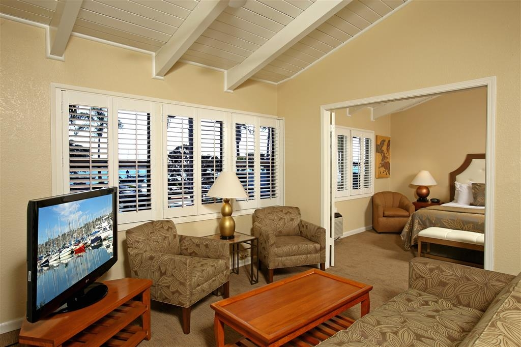 Best Western Plus Island Palms Hotel & Marina - Suites feature separate living rooms with a queen sofa sleeper, full kitchen and private patio or balcony with a water view.
