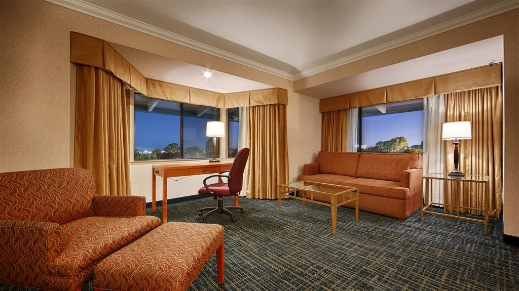 Best Western De Anza Inn - There is ample seating to work or read in our king guestroom.