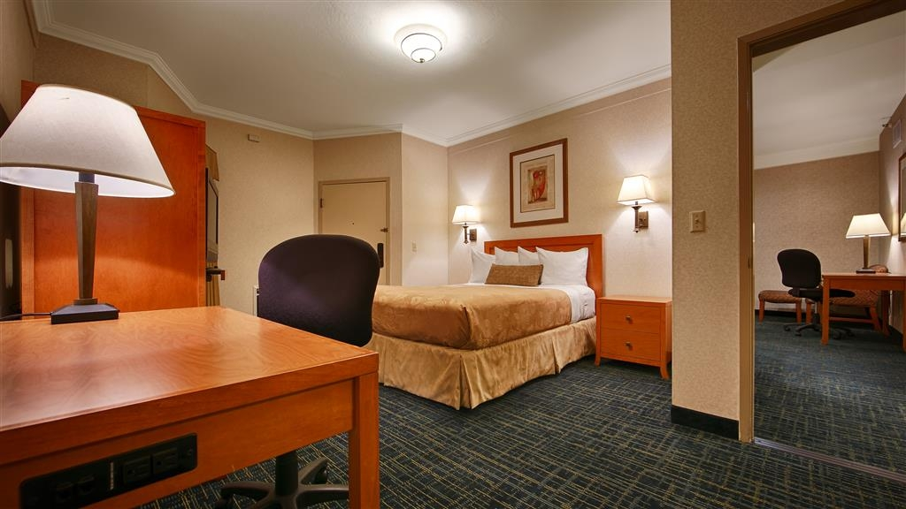 Best Western De Anza Inn - Family suite bedroom one features a single queen bed for privacy.