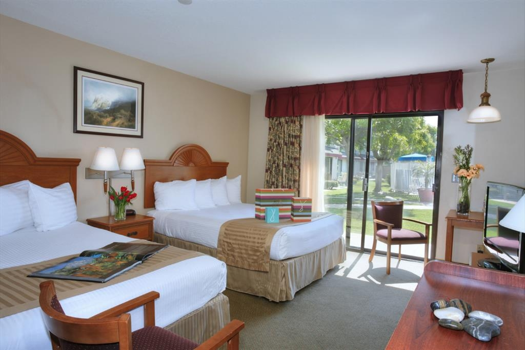 Best Western Westminster Inn - Comfortable guest room with two queen size beds and a courtyard patio.
