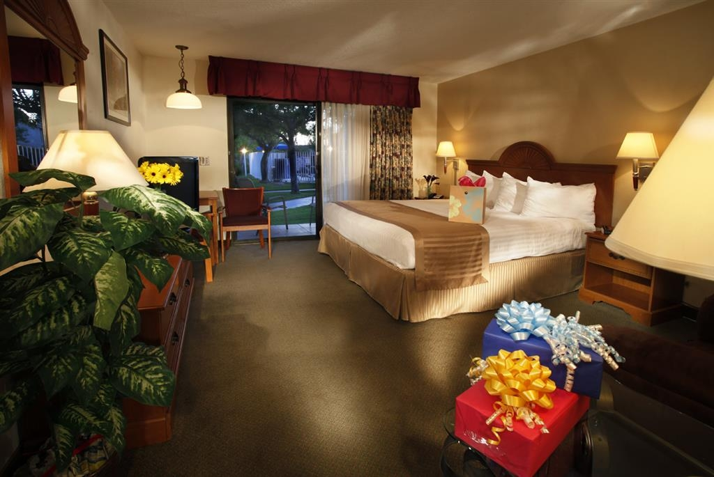 Best Western Westminster Inn - California king bed guest room with a courtyard patio.