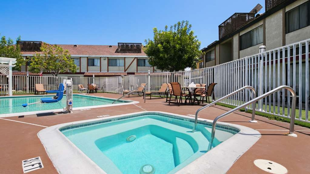 Best Western Westminster Inn - Relax by the pool and spa area fruit trees and rose garden on the side of the pool