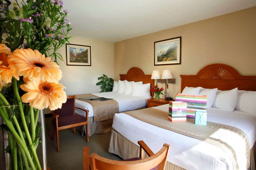 Best Western Westminster Inn - Comfortable guest room with two queen beds and a courtyard view.