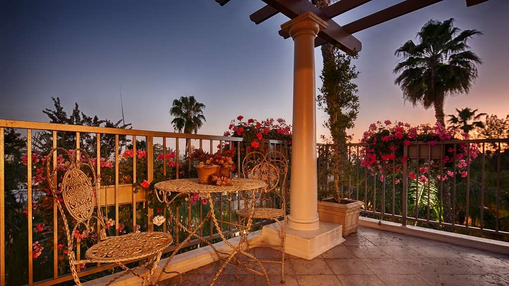 Best Western Plus Sunset Plaza Hotel - Enjoy the breathtaking views from your balcony suite.