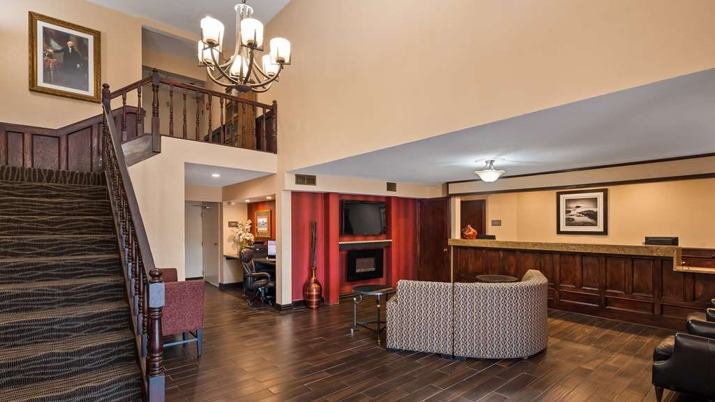 SureStay Plus Hotel by Best Western Omaha South - Our lobby is the perfect spot to relax and grab a newspaper after a long day.