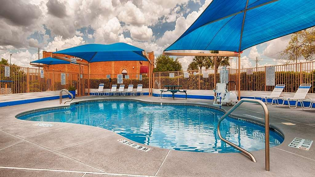 SureStay Hotel by Best Western Mission - Whether you want to relax poolside or take a dip, the outdoor pool area at the SureStay® Hotel by Best Western Mission is the perfect place to unwind.