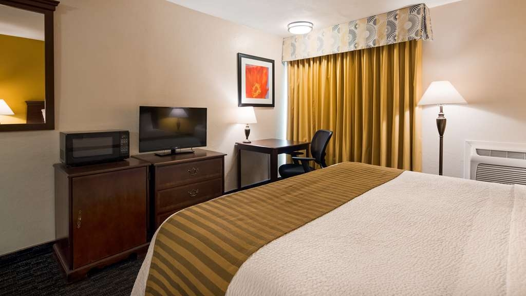 Best Western Village Inn - Sink into our comfortable beds each night and wake up feeling completely refreshed.