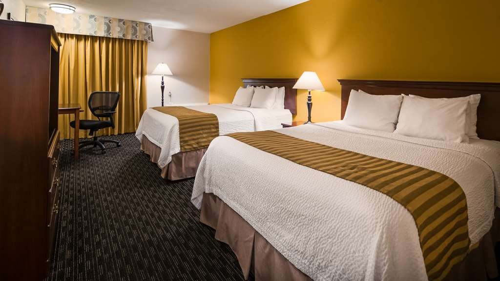 Best Western Village Inn - Our standard Two Queen Guest Room offers the comforts of home with a few added amenities that will make your stay extra special.