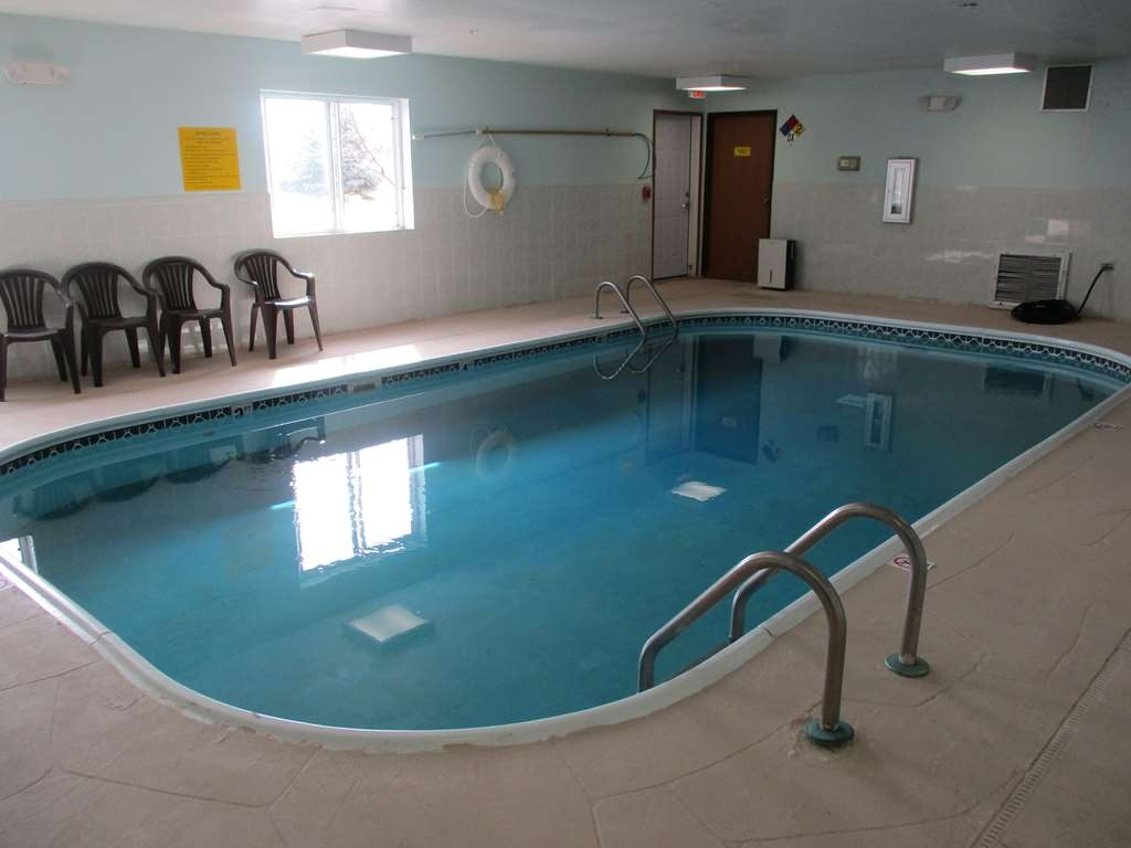 SureStay Plus Hotel by Best Western Bettendorf - Whether you want to relax poolside or take a dip, our indoor pool area is the perfect place to unwind.