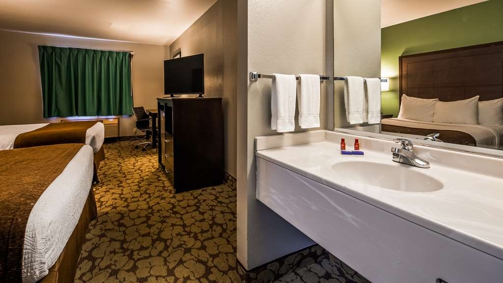 SureStay Plus Hotel by Best Western Bettendorf - All guest bathrooms have a large vanity with plenty of room to unpack the necessities.