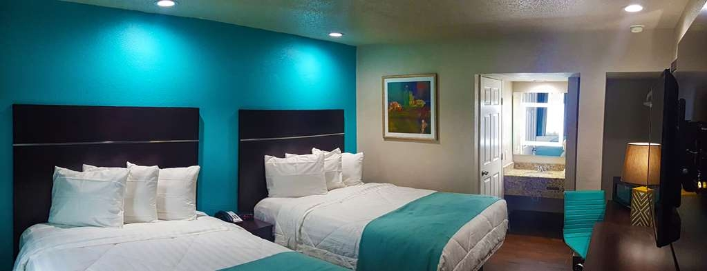 SureStay Hotel by Best Western Laredo - At the end of a long day, relax in our clean, fresh 2 queen rooms.