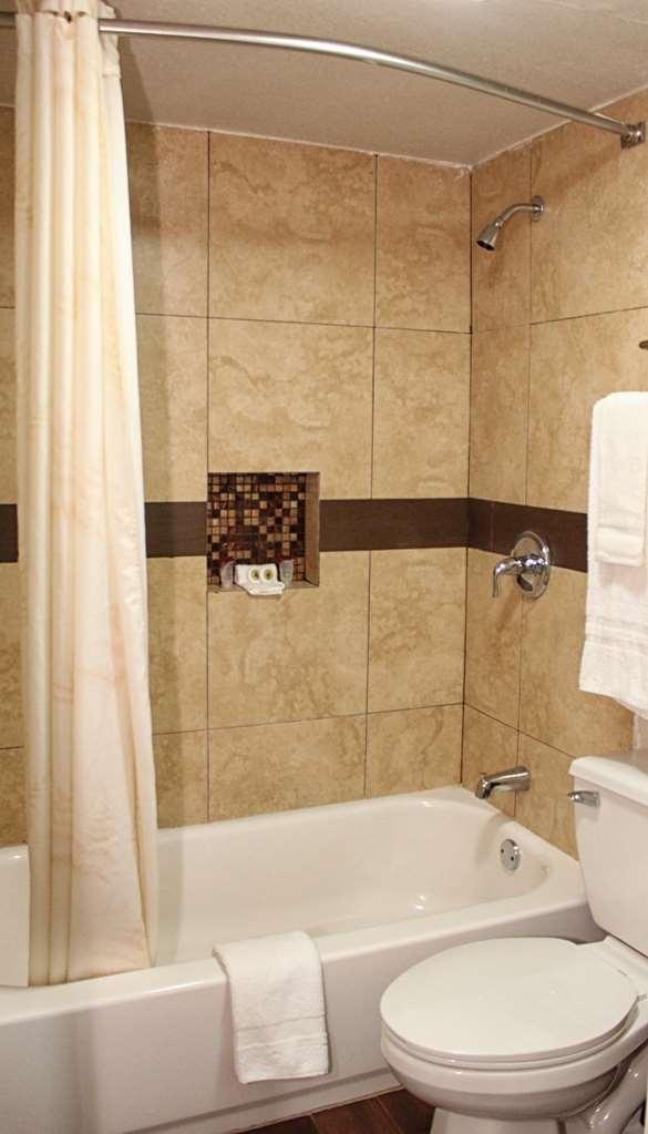 SureStay Hotel by Best Western Laredo - Newly renovated guest bathrooms with tubs and extra touches for a modern feel.