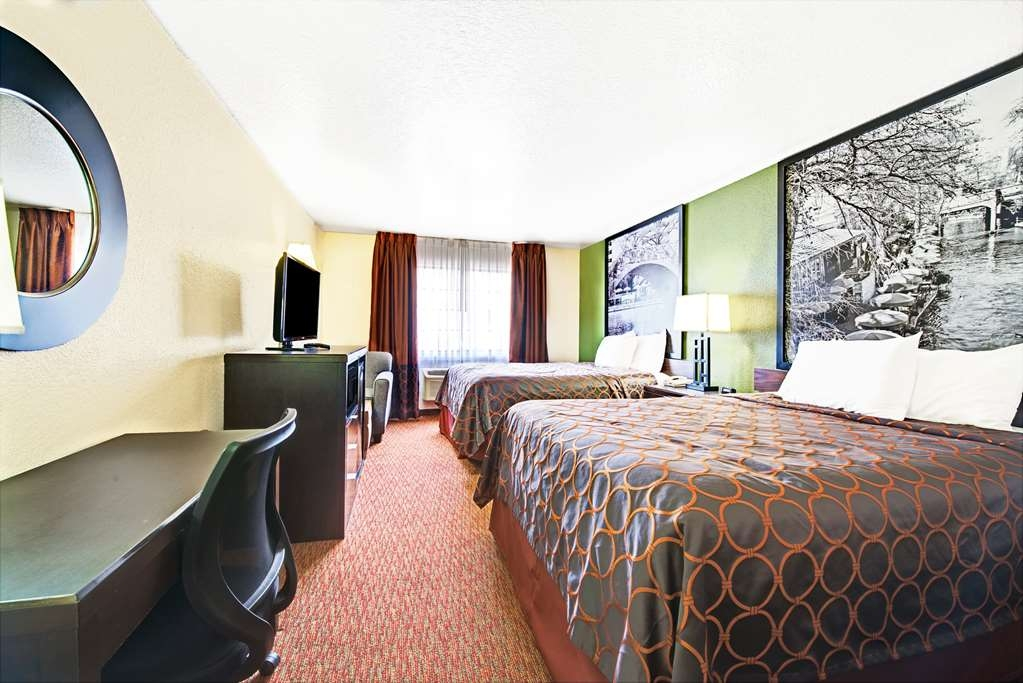 SureStay Plus Hotel by Best Western San Antonio Airport - Pull back the covers, hop in and catch your favorite TV show in our 2 king bedroom.
