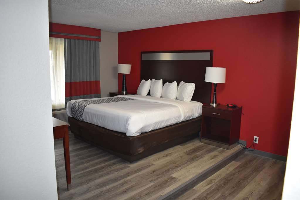 SureStay Plus Hotel by Best Western San Antonio North - Live in true luxury in our king suite with a wet bar featuring separate bedroom, 2 flat screen TV's, a microwave and fridge.