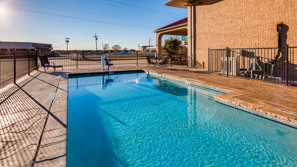 SureStay Hotel by Best Western Terrell - Whether you want to relax poolside or take a dip, our outdoor pool area is the perfect place to unwind.