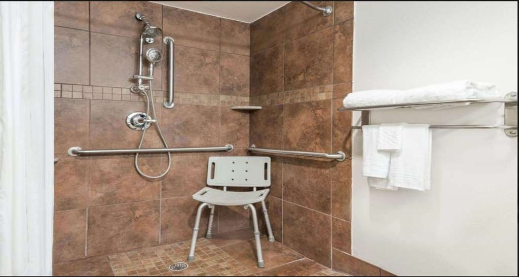 SureStay Plus Hotel by Best Western Lubbock Medical Center - We designed our mobility accessible bathrooms for easy access.
