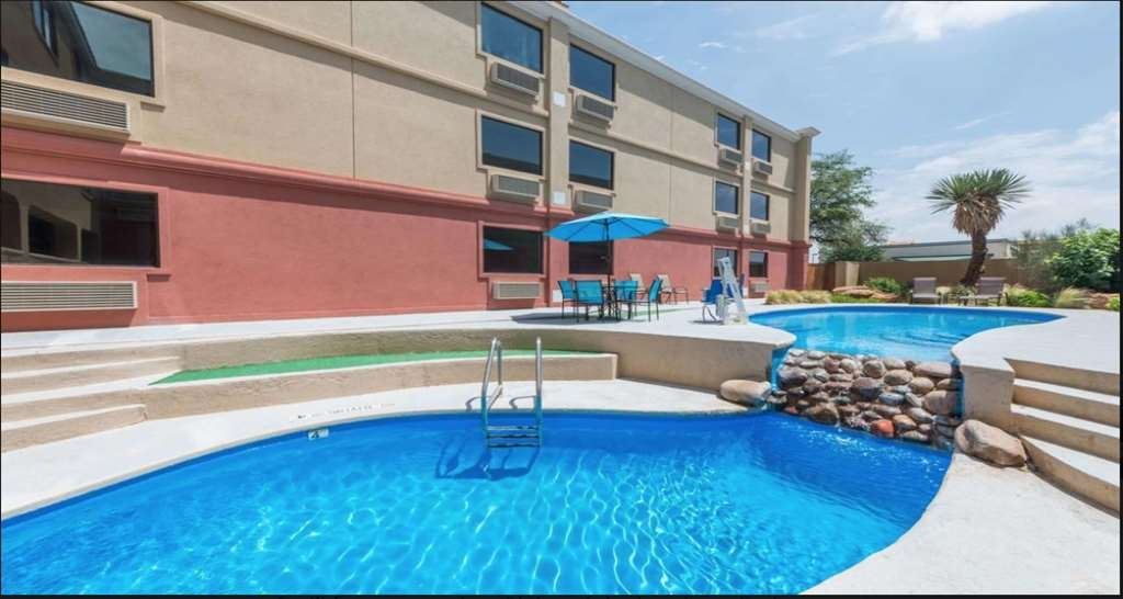 SureStay Plus Hotel by Best Western Lubbock Medical Center - Take a refreshing dip or swim some laps in our outdoor pool.