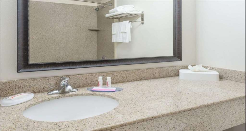 SureStay Plus Hotel by Best Western Lubbock Medical Center - All guest bathrooms have a large vanity with plenty of room to unpack the necessities.