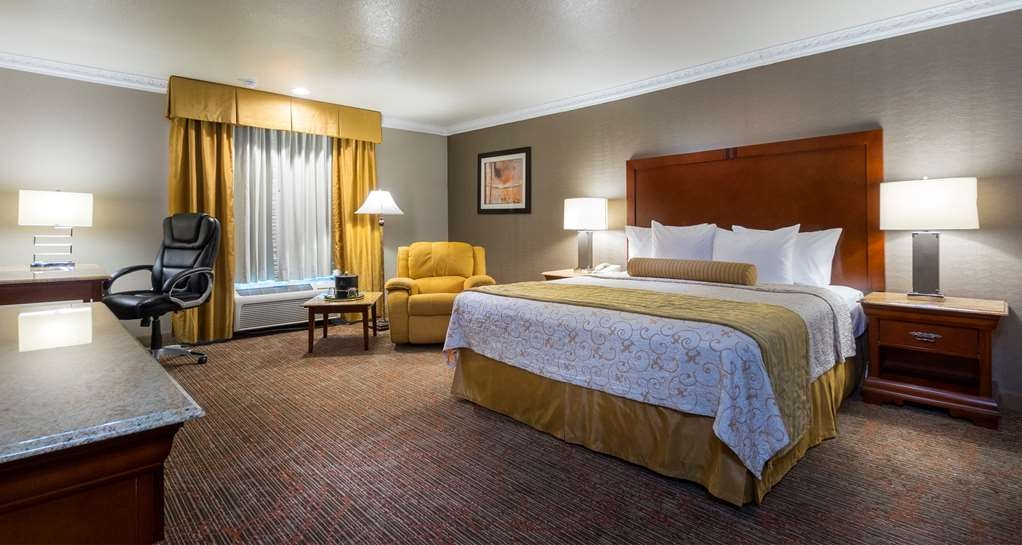Best Western Plus Newport Mesa Inn - Guest Room with extra amenities such dental Kit, shaving Kit, Bathrobe, slipper, mouthwash and extra