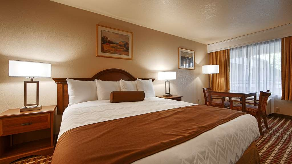 Best Western Heritage Inn - Stretch out and relax in the King Guest Room.
