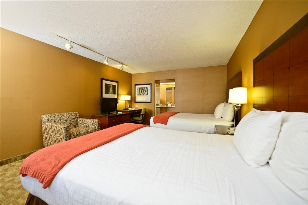 Best Western Inn at Palm Springs - Our two queen bed guest room with has a LCD TV, wireless internet, safe, refrigerator, coffee maker and iron/ironing board.
